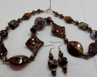 Brown beaded necklace and earring set.