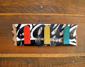 Coat rack from recycled skateboard