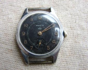 Soviet vintage wrist watch RAKETA Pchz / black dial wrist watch Petrodvoretz factory Russian Soviet Vintage 1960s