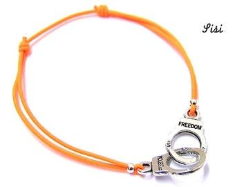 Silver cuff bracelet orange cord