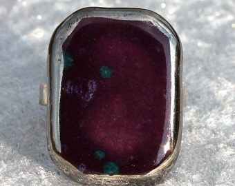 Pretty violet ring of ceramics with green spots.