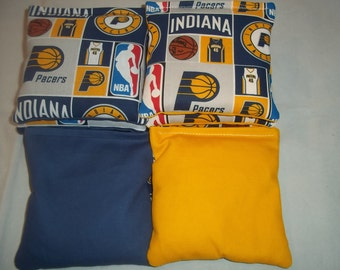 8 ACA Regulation Cornhole Bags - 8 handmade from Indiana Pacers Fabric with Yellow & Blue Backs
