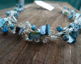 Hand crocheted turquoise blue necklace.