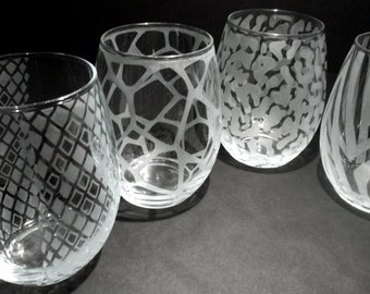 Wine glasses hand etched with animal print. Stemless wine glasses with snakeskin, zebra, giraffe, leopard.