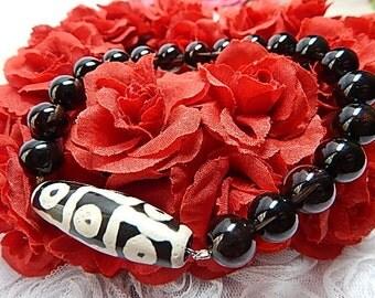Black Obsidian Bracelet with Tibetan Nine Eyed Dzi.