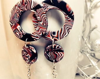 Large statement earrings by Felicianation in red, black, white and silver