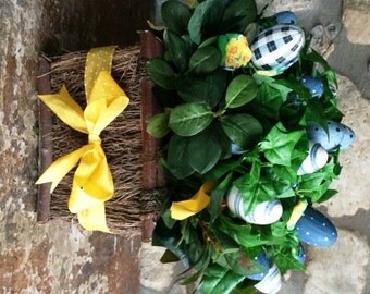 Wooden Table Basket filled with Blue Eggs and Yellow Bows