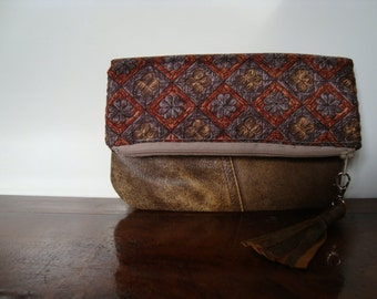 Composition of light brown recycled leather and beautiful vintage fabric