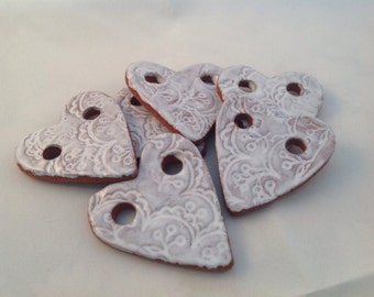 6 little harts of red clay with white tin glaze