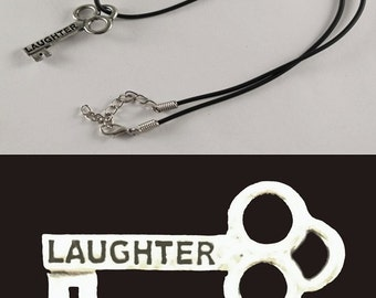 "Laughter Mini Key Necklace with 18"" - 19 1/2"" Adjustable Black Cord"