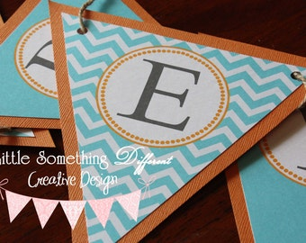 Orange and Teal alternating Chevron and Solid Patterned Banner