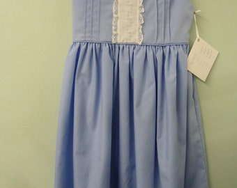 Mid Yoke Dress with voile collar and ties.