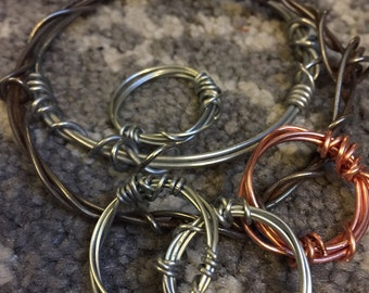 Hand made, twisted wire rings in copper and steel, to match our Haywire Bracelets