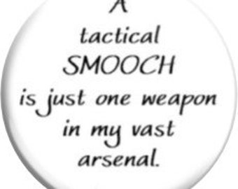 FD3202 - A tactical smooch. Item  FD3202  - 1.25 inch Metal Pin back Button or Magnet