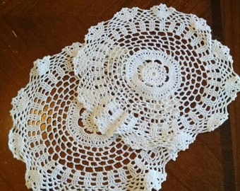 Two matching vintage hand crocheted doilies doily