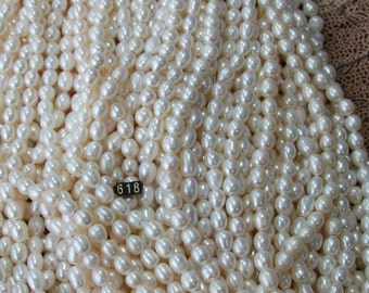 10-11mm #618 White Oval  large hole freshwater pearls