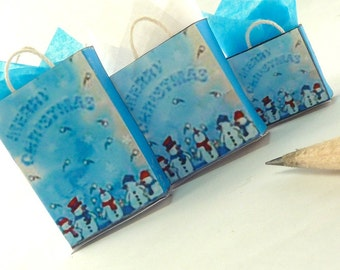 Christmas gift bags with snowmen at the bottom dollhouse miniatures 1/12 scale.