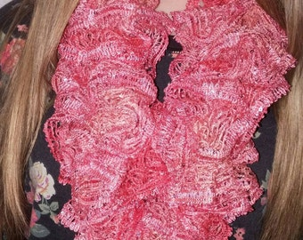Coral colored ruffle scarf with tiny sequins. Lovely!