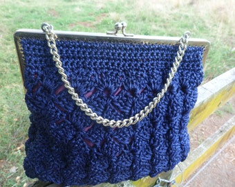 Handknitted purse 1975.