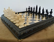 Beautiful Florentine custom chess set made from Poplar and Oak. Exquisitely carved, hand painted frame, brass corners and underside storage.
