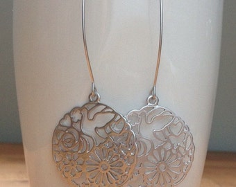 Round matte silver daisy and dove filigree earrings
