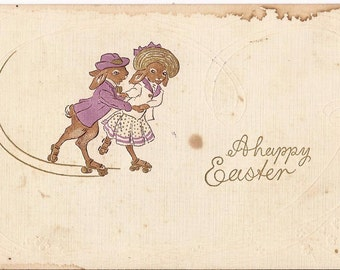 """Antique Easter postcard, """"A Happy Easter"""", embossed, couple of rabbits rollerskating, blank back"""