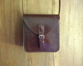 Leather bag. Crossbody bag. Medium size. Hand sewn. Dark brown. Bag with buckle.