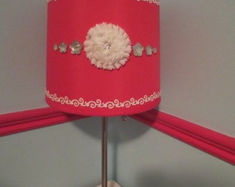 Girly Glam Lamp w/hot pink shade, white floral embellishment, crystal-like embellishments, white border w/slight sparkle. Fun & fabulous!