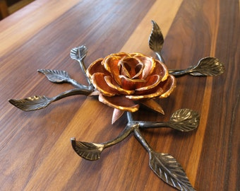 Copper rose hammered and forged by hand.