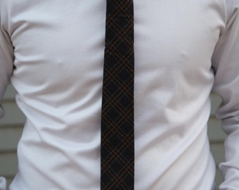 Dark blue, brown, and white plaid skinny necktie