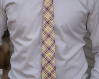 Light gray, mustard yellow, pink, and off white plaid skinny necktie