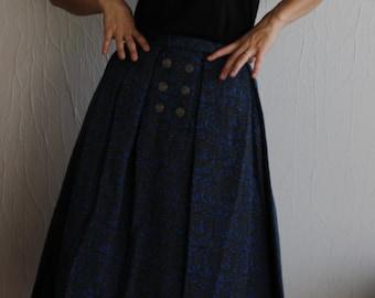 Superbe jupe en laine fond gris et motif bleu des années 1950