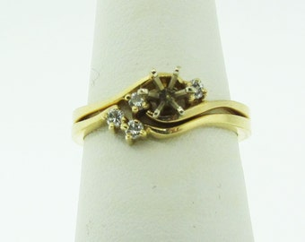 14 karat gold and diamond engagement and wedding setting.