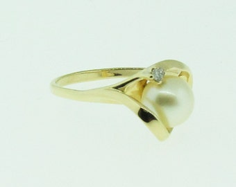 Antique Pearl and diamond gold ring.