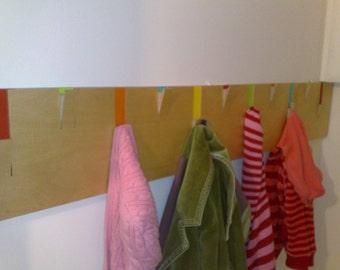 Beautifully colourful handmade plywood coat pegs