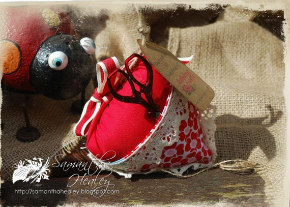 Red facric Pincushion with thread scissors