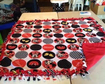 Double sided, hand tied fleece Minnie Mouse blanket.