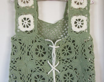 Vest-Attractive Woman's Granny Square vest is crochet in a pale olive yarn. It's back is a single lacy square of shells & network of chains.