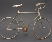 Mini Bicycle sculpture, a 'mini bicycle' sculpture handcrafted from copper, copper coated steel and bronze.