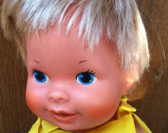 1978 GMFGI Kenner drink n wet doll with 1 piece soft body , rooted hair, painted eyes.