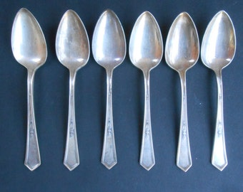 6 Rogers Silverplate spoons XII