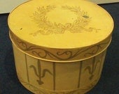 Large Metal Hat Box Golden Colored with Green Laurel Wreath Design on Lid  Vintage..SALE... REDUCED to 25 Dollars