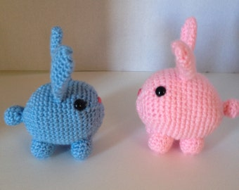 Handcrafted small crocheted bunny in varying colors