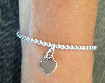 Silver ball bracelet with heart charm