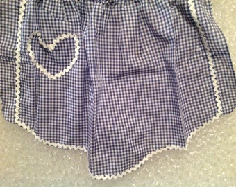 Two vintage aprons.