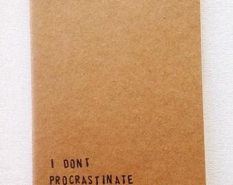 Moleskine style kraft card notebook hand stamped message Procrastinate quote