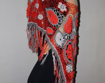 The crochet-made, lace shawl with fringes