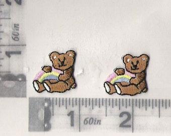 Tiny pair of teddy bears holding a rainbow iron on patch
