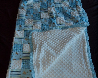 Blue quilted puppy baby blanket