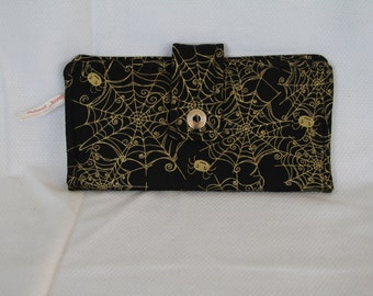 Wallet with spiders and webs